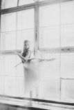 Ballerina dancing at window sill background Stock Images