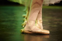Ballerina dancing. Young ballerina dancing close up on her shoes Stock Photo