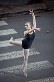 Ballerina doing ballet outdoor Stock Images