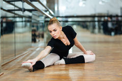 Ballerina doing stretching exercises in ballet class Royalty Free Stock Photos