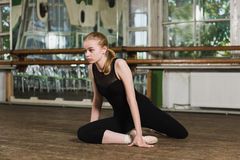 beautiful ballerina stands in ballet plie position stock