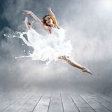 Ballerina in dress of milk Stock Images