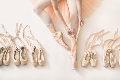 Ballerina is dressing in studio Royalty Free Stock Photography