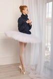 Ballerina drinking black tea near the window Stock Image
