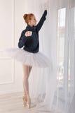 Ballerina drinking black tea by the window Royalty Free Stock Photos