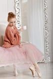 Ballerina drinking coffee Royalty Free Stock Photography