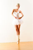 Ballerina exercising ballet pose in the studio Stock Image