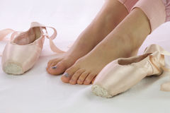 Ballerina feet near pointe shoes isolated royalty free stock images