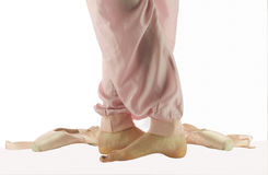 Ballerina feet standing in fifth position royalty free stock image