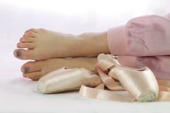 Ballerina feet tired to work with pointe shoes royalty free stock images