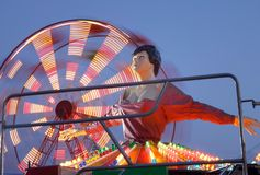 Ballerina and ferris wheel at amusement park royalty free stock photos