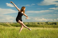 Ballerina in field Royalty Free Stock Images
