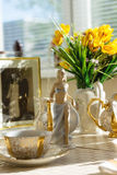 Ballerina figurine at the table with Cup of tea, summer flowers Royalty Free Stock Image