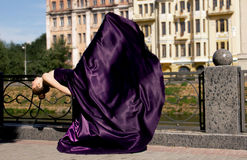 ballerina flats on the street in a long purple dress dancing alone in the summer of Sunny Day royalty free stock photos