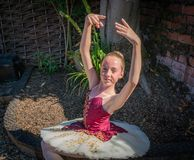 Ballerina in a garden stock photos
