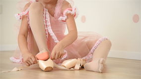 Ballerina Gathers Her Pointe. Little Ballerina Girl  In Pink Tutu Gathers Her Pointe stock video footage