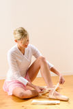 Ballerina getting dressed for ballet performance. Woman pointe tying dressing Stock Image