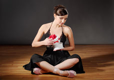 Ballerina with gift Royalty Free Stock Photo