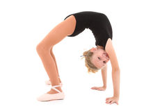 Ballerina Girl Back Bend with Clipping Path. Happy eight year old caucasian girl in ballerina uniform doing bridge up, back bend over white with clipping path royalty free stock photos
