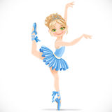 Ballerina girl in blue dress dancing on one leg Royalty Free Stock Photos