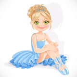 Ballerina girl in blue dress sit on floor Stock Photo