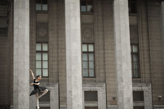 Ballerina. Girl ballerina flats standing on tiptoes on the street royalty free stock photo