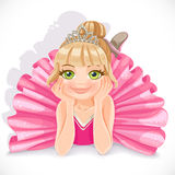 Ballerina girl in pink dress lie on floor Royalty Free Stock Photo