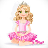 Ballerina girl in pink dress sit on floor Stock Photography