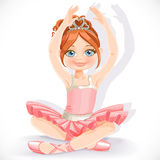 Ballerina girl in pink dress sit on floor Royalty Free Stock Photography
