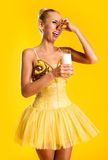 Ballerina with glass of milk Royalty Free Stock Photography