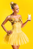 Ballerina with glass of milk Royalty Free Stock Photos
