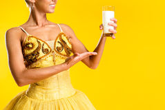 Ballerina with glass of milk or yoghurt Royalty Free Stock Images