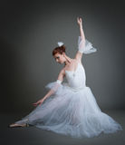 Ballerina on a grey background Stock Images