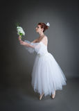 Ballerina on a grey background Stock Photo