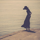Ballerina in the hat and black dress is dancing. Royalty Free Stock Photos