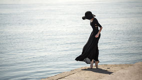 Ballerina in hat and black dress. Royalty Free Stock Photography