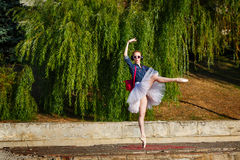 Ballerina hipster dancing on the street. Royalty Free Stock Image