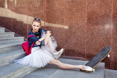 Ballerina hipster sits on the steps. Royalty Free Stock Photo