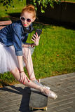 Ballerina hipster sitting on the bench. Stock Image