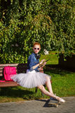 Ballerina hipster sitting on the bench. Stock Photo