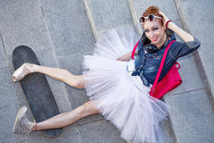 Ballerina hipster sitting on the stairs. Royalty Free Stock Image