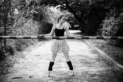 Ballerina holding boom gate Royalty Free Stock Photo