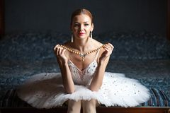 Ballerina holding pearl necklace Stock Photos