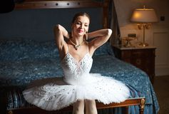 Ballerina holding pearl necklace and smiling Royalty Free Stock Photo