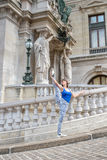 Ballerina on holiday  making a pose with her leg high up in the Stock Images