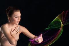 Ballerina i pointes och handlag för en klänning sensually litet arkivbilder