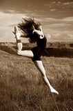 Ballerina jumping Stock Photography