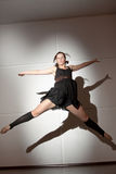 Ballerina jumping. Sexy young ballerina dancer jumping during a dance Royalty Free Stock Image