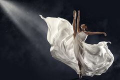 Free Ballerina Jumping In White Silk Dress, Modern Ballet Dancer In Pointe Shoes, Fluttering Waving Cloth, Gray Background Royalty Free Stock Images - 196485949