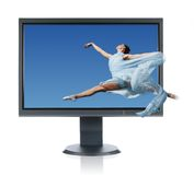 Ballerina jumping into a monitor Royalty Free Stock Photography